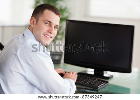 Shadowing a smiling young businessman - stock photo