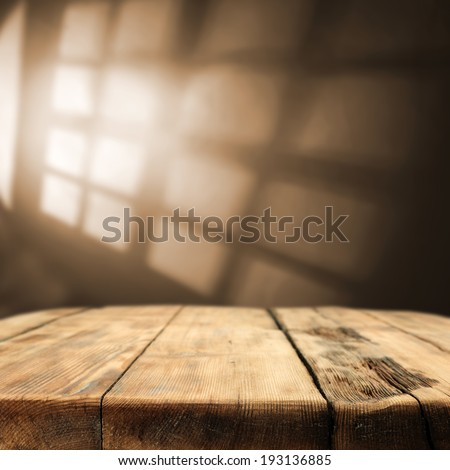 shadows od window and wooden table with few desk  - stock photo