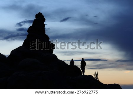 Shadows of a Couple watching the Sunset in the Arches National Park in Moab, Utah - stock photo