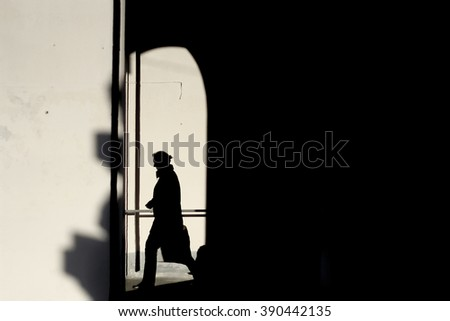 Shadows of people walking in a street of the city. Kiev.Ukraine - stock photo