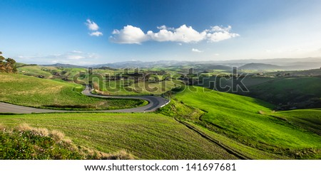 Shadows on beautiful green hills in Tuscany, Italy.