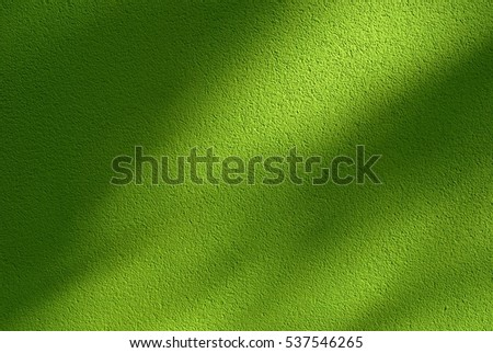 Shadows on green painted wall; abstract background.