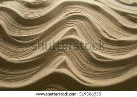 Shadows on the sand wave. Background from fine sand and texture.