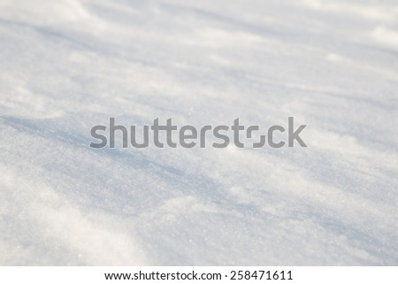 Shadows on the snow. Natural background. - stock photo