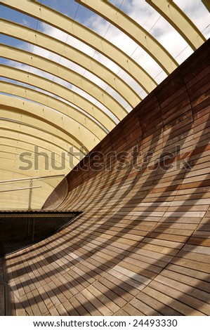 Shadows on wooden arc wall