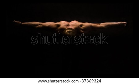 shadowy torso of a bodybuilder, highlighting muscles of the arms and upper body.