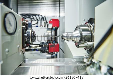 shaft detail turning on metal cutting machine tool at manufacturing factory - stock photo
