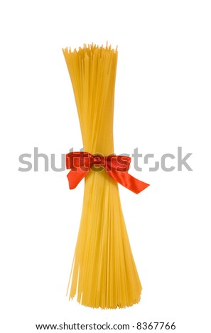 shaft of spaghetti with red bow,isolated on white background - stock photo