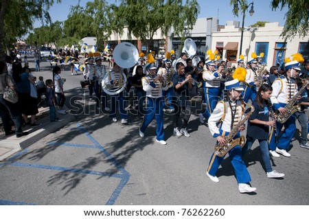 SHAFTER, CA - APR 30: The Cinco de Mayo Festival parade on April 30, 2011, at Shafter, California. The high school band entertains the crowd. - stock photo