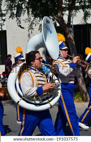 SHAFTER, CA - MAY 3, 2014: The Richland High School band excites the spectators with their music and precision marching during the Cinco de Mayo Celebration parade. - stock photo
