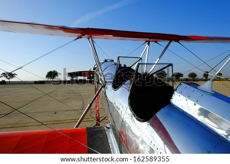SHAFTER, CA - NOV 2: A vintage Myers Biplane sports a shiny aluminum fuselage and lots of wing area at the Minter Field Fly-In on Nov 2, 2013, at Shafter, California.