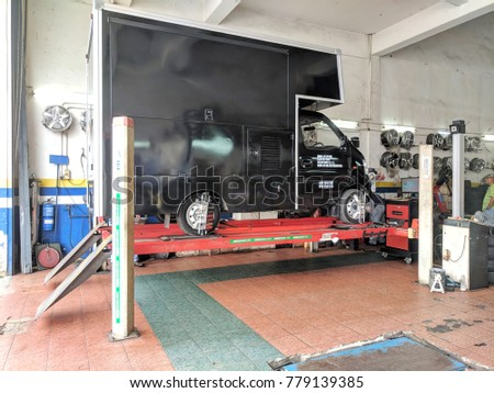 SHAH ALAM, MALAYSIA - DECEMBER 02, 2017 : A black truck having its wheels service at local workshop.