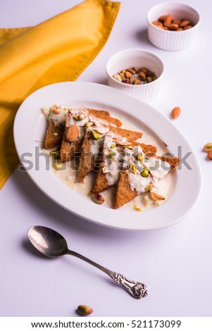 Shahi Tukda, a sort of bread pudding using sweet rabdi with dried fruits, selective focus