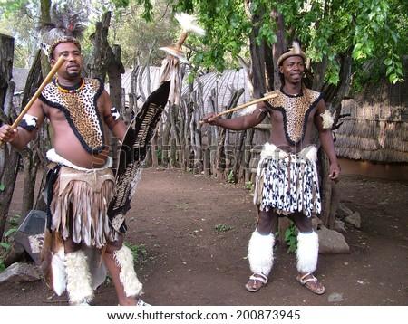 Zulu warrior stock images royalty free images vectors shakaland south africa circa november 2011 unidentified zulu men wearing traditional zulu warrior stopboris Images