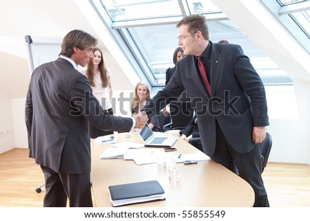 shake hands between boss and a new client - stock photo