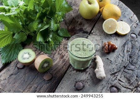 shake nettles with kiwi apples and ginger detox drink for a vegetarian diet - stock photo