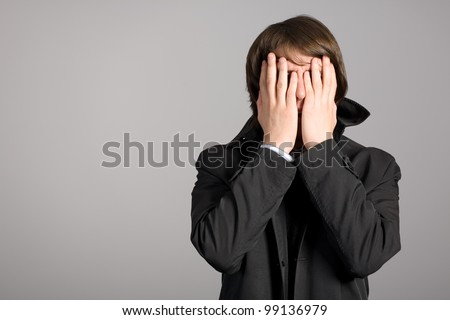 Shaken by a man put his hands face. - stock photo