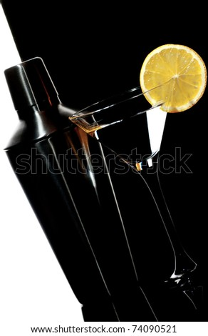 Shaker and cocktail in martini glass on a  white and black background - stock photo
