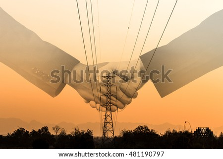 Shaking Hand Agreement Electrical Transmission Tower Stock Photo