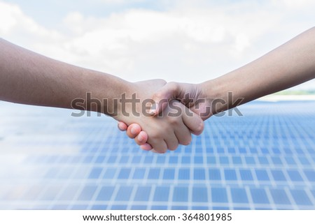 Shaking hands. From Solar Cell Farm, Thailand
