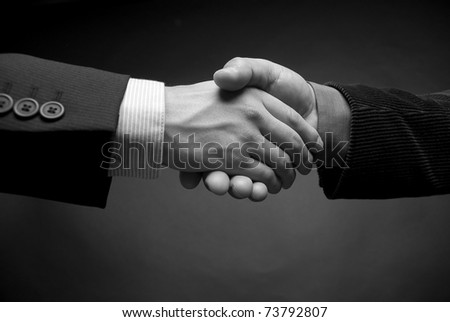 shaking hands in black and white - stock photo