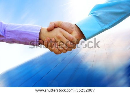 Shaking hands of two business people - stock photo