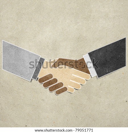 shaking hands recycled paper craft stick on paper background - stock photo