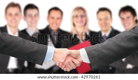 shaking hands with wrists and six business group out of focus collage - stock photo