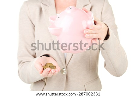 Shaking out piggy bank - stock photo