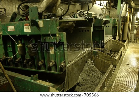 Shale shakers on an offshore oil rig - stock photo