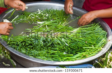 shallots in cambodian market being washed cambodia siem reap asia - stock photo