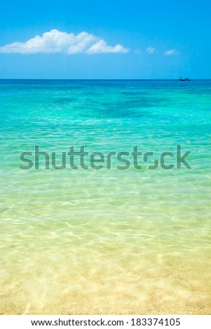Shallow clear sea water by the sand shore