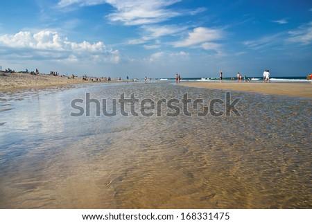 Shallow clear tidewater at Nobska Beach on Cape Cod in Massachusetts. - stock photo