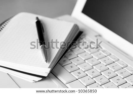 Shallow depth of field, focus on the tip of the pen and the area nears it - stock photo