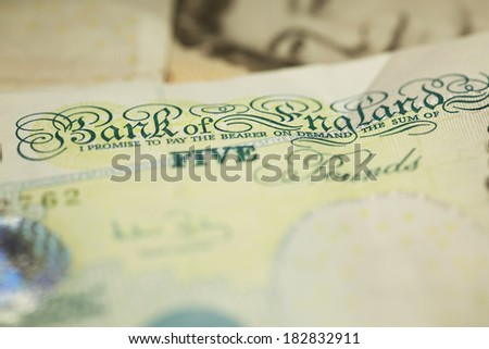 Shallow depth of field highlighting the Bank of England text on a UK Currency Five Pound Note. Finance concept - stock photo