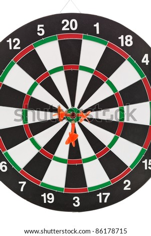 Shallow depth of field shot of darts in bullseye on dartboard - stock photo