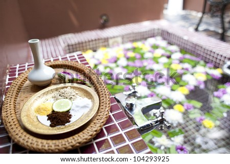 Shallow depth spa massage setting with thai herbal compress stam - stock photo
