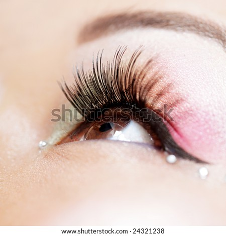 Shallow DOF on a beautiful eye in creative makeup - stock photo