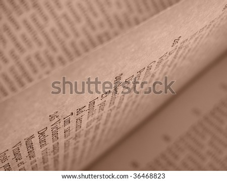 shallow DOF sepia toned open book pages with ancient latin text of Aeneid by Virgil - stock photo