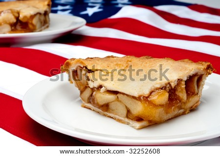Shallow focus horizontal image of 2 pcs of apple pie on the American flag - stock photo