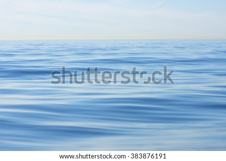 Shallow focus on gentle swell in endless calm sea with hazy horizon at La Jolla Shores, California - stock photo