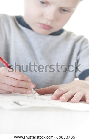 Shallow focus on pencil of boy erasing mistake - stock photo
