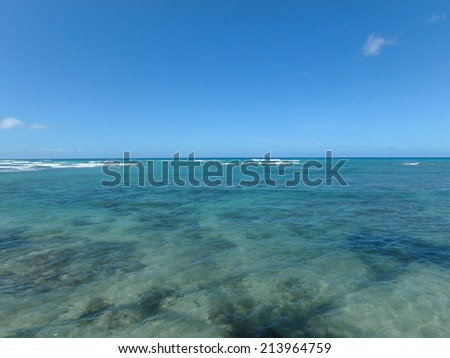 Shallow ocean waters of Waikiki looking into the pacific ocean.  - stock photo