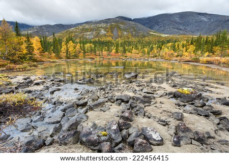 Shallow Polygonal lake shore in Hibiny mountains above the Arctic Circle - stock photo