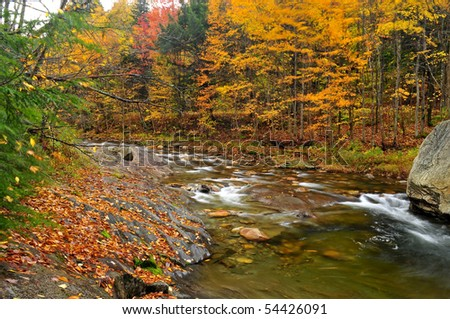 Shallow Rocky Brook in Vermont in the fall - stock photo