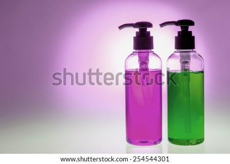 Shampoo and gel bath body care product on backlight background - stock photo