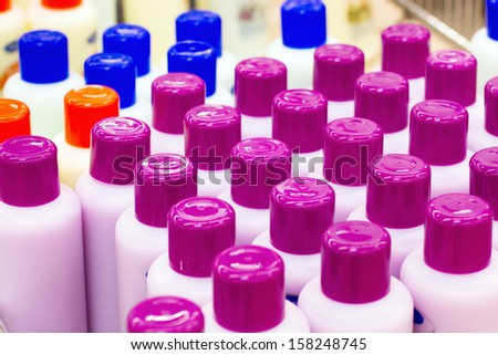 shampoo and shower gel in the shop - stock photo