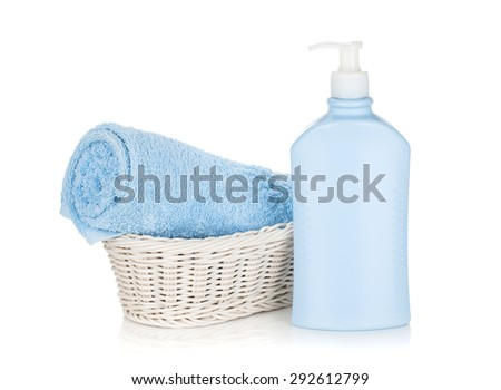 Shampoo bottle and blue towel. Isolated on white background
