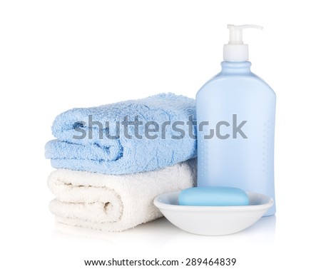 Shampoo bottle and soap with towels. Isolated on white background - stock photo