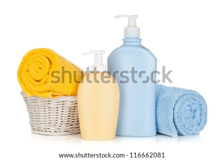 Shampoo bottles and towels. Isolated on white background